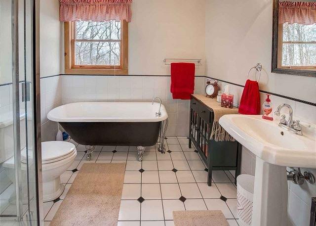 Master bathroom w/ claw foot soaking tub and walk in shower