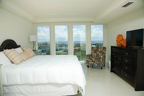 The master bedroom offers and exquisite king size bed and offers views toward the bay.