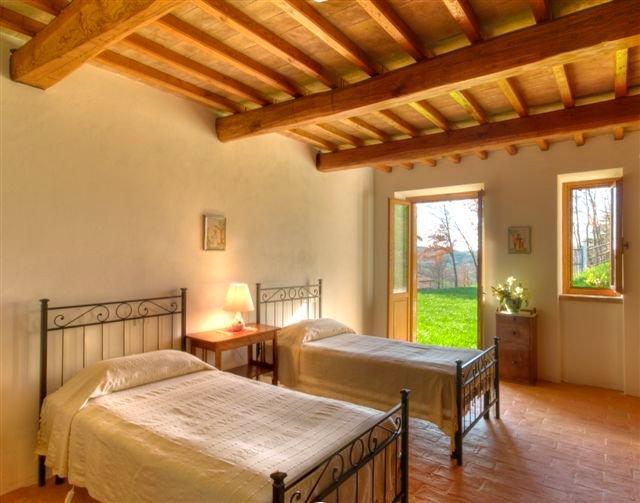Twin bedroom with ensuite full bathroom. French door to the garden