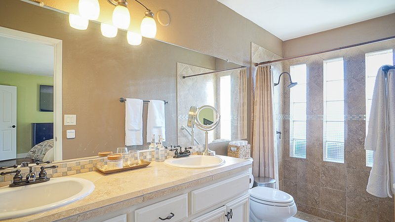 Master bath located in the master bedroom. Double sinks and a beautiful sunken shower