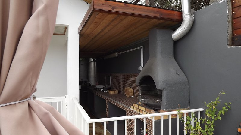 barbecue area next to the pool
