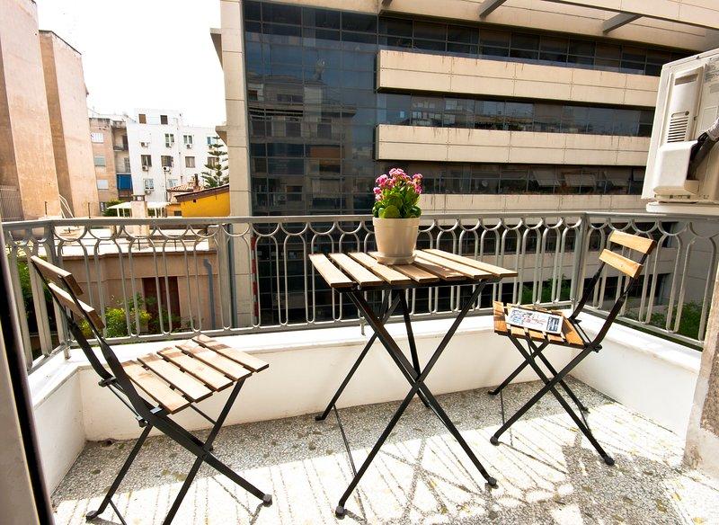 The balcony overlooks the wide & full of trees Ipirou str.