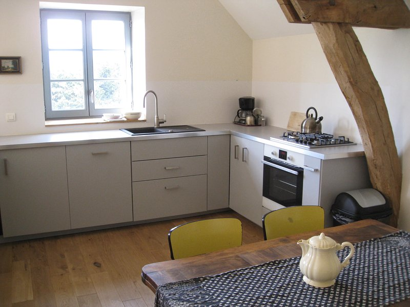 kitchen with integrated oven, dishwasher and refrigerator