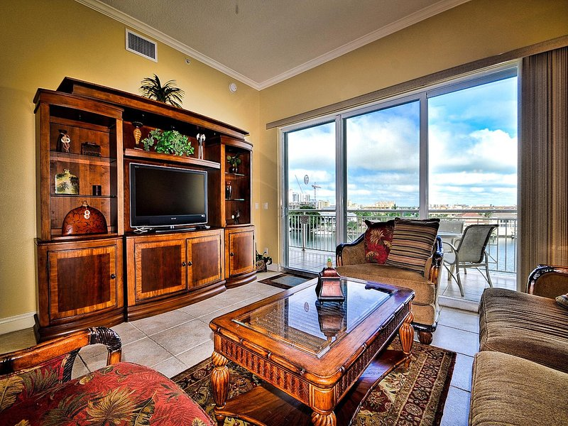 Living room has a flat screen TV and access to the balcony.