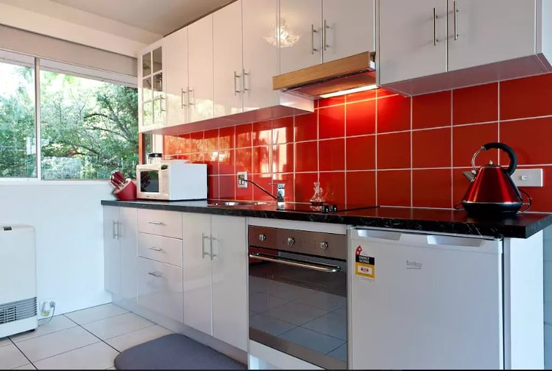 Designer kitchen, SMEG oven, cooktop, fully supplied, and thermostat controlled centralised heating.