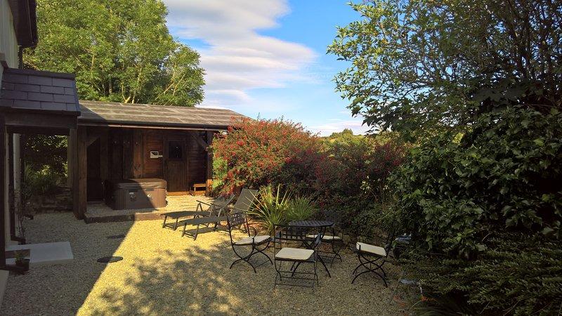 backyard with  hot tub, sauna and garden furnitures