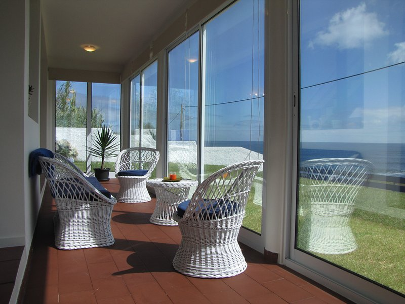 Enjoy coffee and a book first thing in the morning in the sun room with an ocean view!