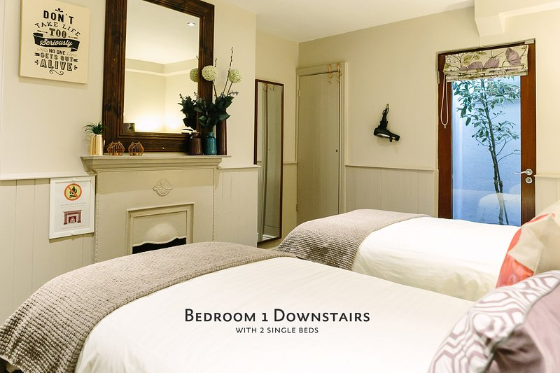 Bedroom 1 Downstairs, with 2 single beds