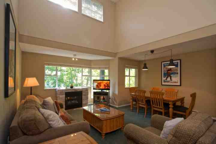 Comfortable and spacious living area with new lighting and ceiling fan