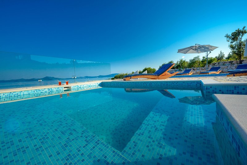 Dubrovnik Riviera Villa with Private Beach & Pools, holiday rental in Kobas