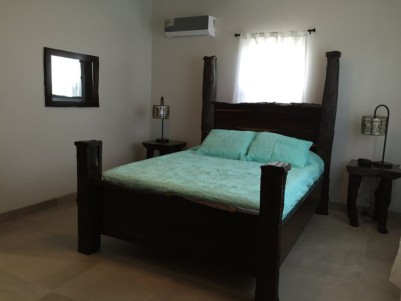 Spacious bedroom with Queen bed, A/C and flat screen TV with access to front patio