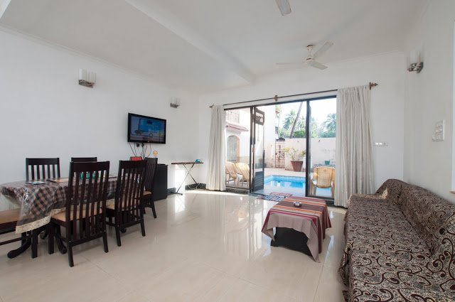 Huge spacious living room attached to private outdoor swimming pool gives a perfect ambiance.
