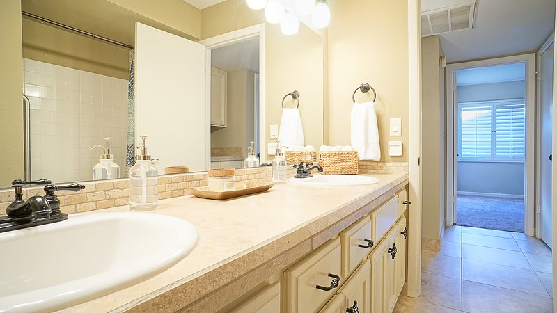 Bathroom # 2 double sinks and a sunken shower and bathtub combo. Close to bedroom # 1&2