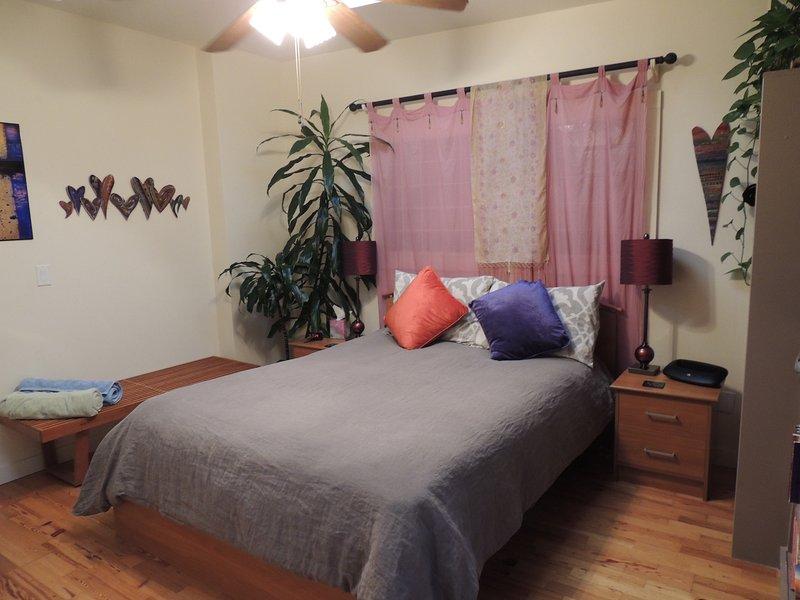 Chambre avec lit queen size Nouveau.