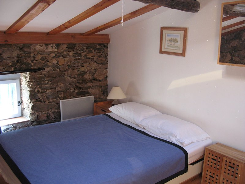 double bedroom with beamed ceiling