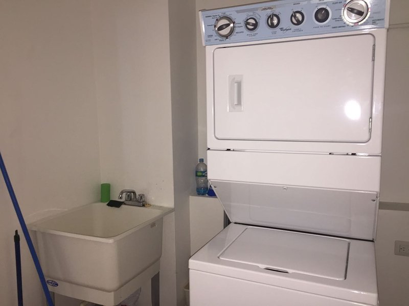 Laundry area with washing and drying center