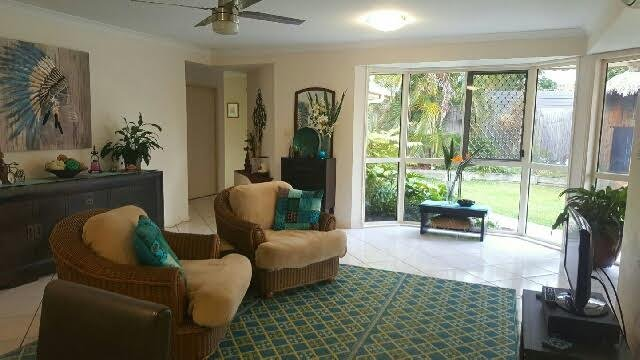 Guests have their own living area near the bedrooms and overlooks  the garden and pool area.