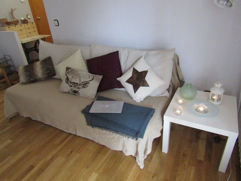 The sofa converts into a bed for two people.