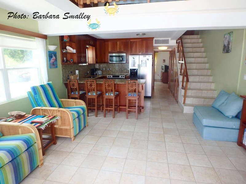 Walk in from the porch to your spacious living area