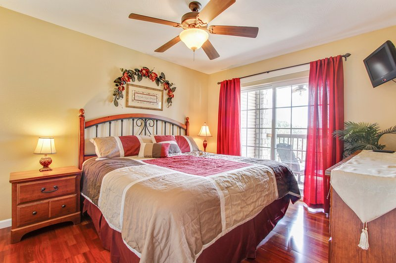 Master bedroom with King pillow top mattress, has access to deck