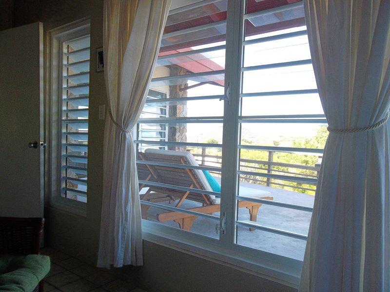 East patio through bedroom windows.