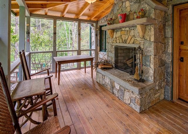 Large covered porch with wood fireplace.