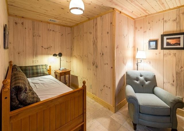 Twin bedroom with trundle on ground level.
