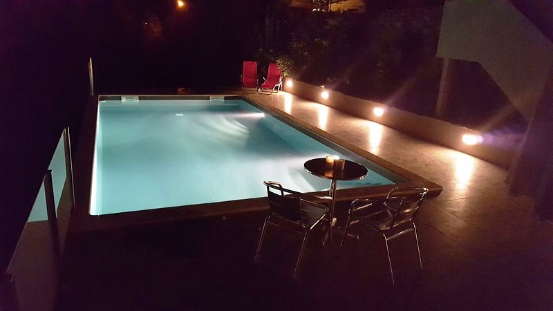 Our pool by night!
