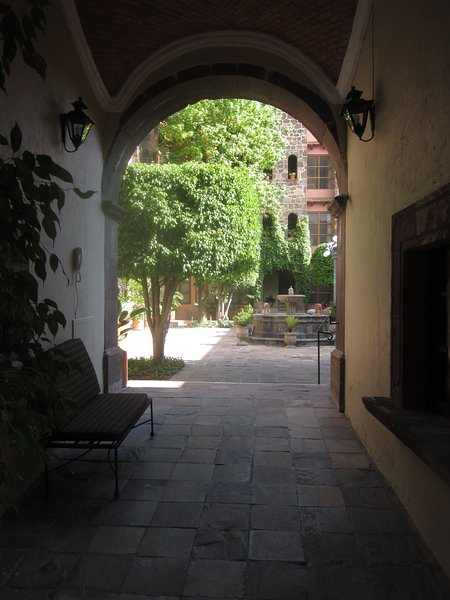 Entry from street to courtyard. Note apt is set in off street, providing extra security and quiet.