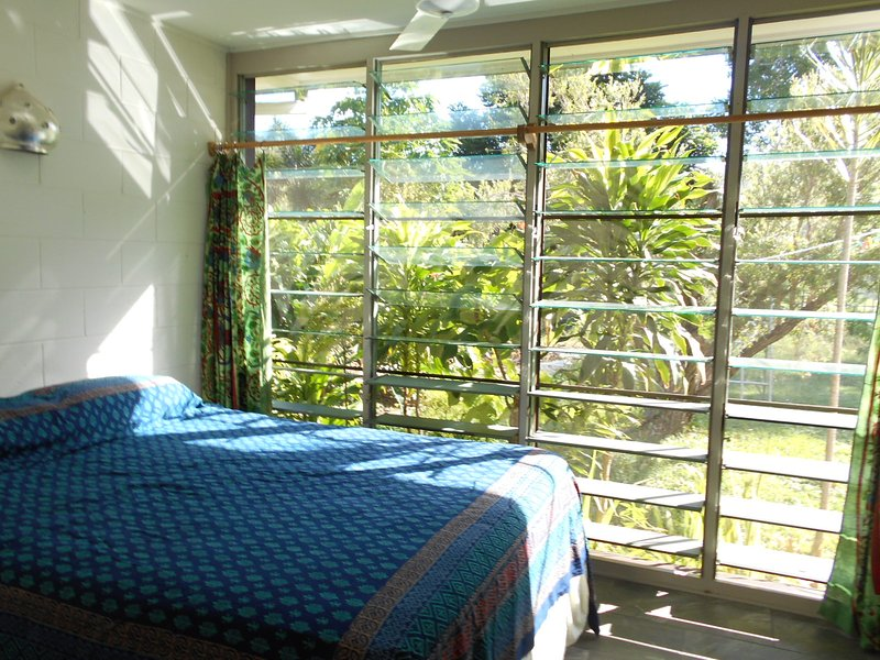 Dream on a Sealy pillow-top Posturepedic queen bed. Wake to tropical garden & mountain views.