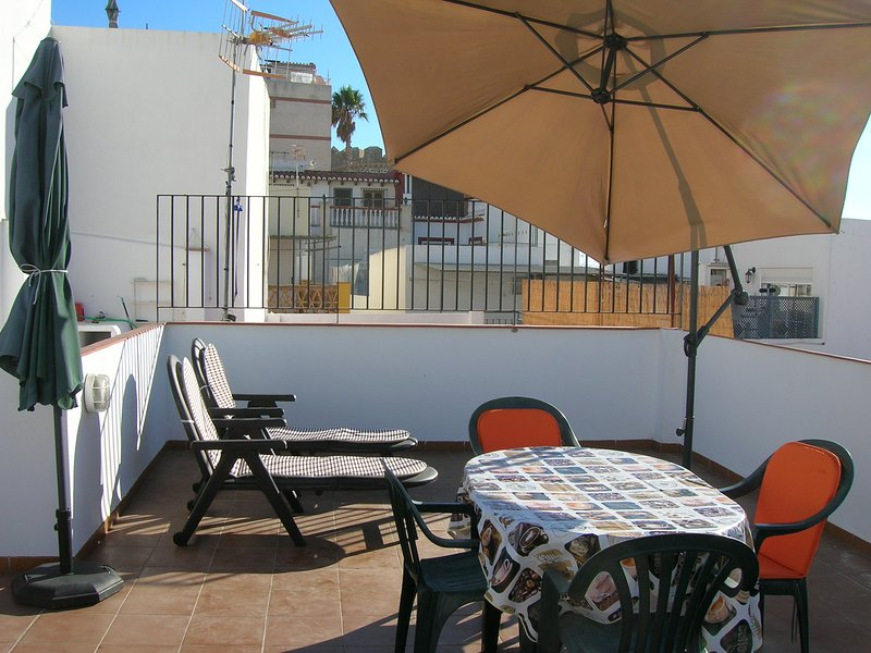 Top terrace with parasol and  Castle in background