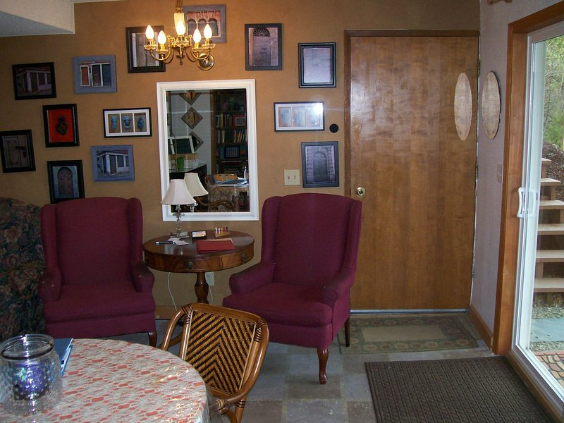 Seating area and dining table by private entrance.