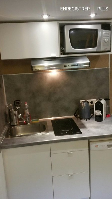 Kitchen with hob, extractor, microwave and new Nespresso.