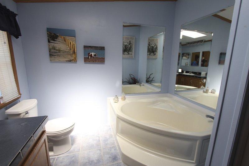 The master bath includes a giant soaking tub.