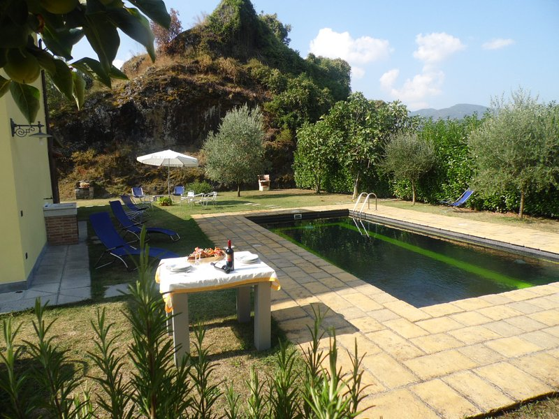 Pool;mountains in background. Dark pool tiles means it blends into scenery temperature is higher