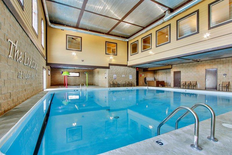 Indoor Saltwater Heated Pool w/ Splash Pad & Hot Tub in corners. - Open Year Round