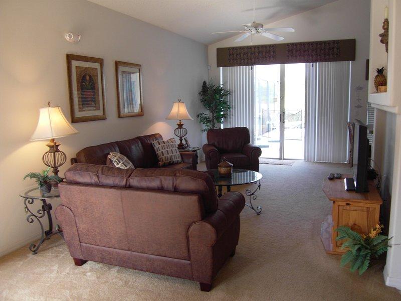 Living Room with Patio Door to Pool Deck