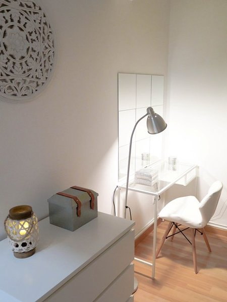Vanity area. warm and very bright, chair ikea style and design.