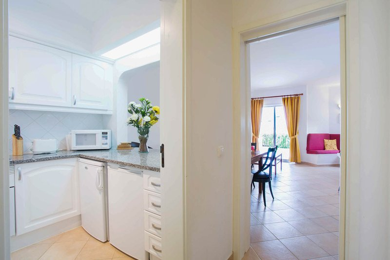 Spacious kitchenette and living area with aircon , free internet and modern flatscreen tv.