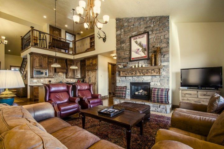 Great room with fireplace, HDTV Direct TV, and entertainment center.