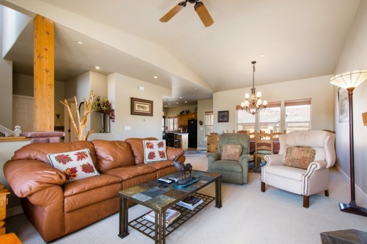 Spacious 3 Bedroom, 2.5 Bathroom townhouse with spacious living and dining, quality furniture and vaulted ceilings.
