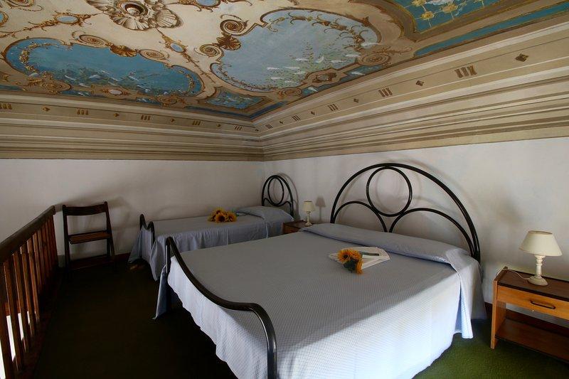 Sleeping area with frescoed ceilings