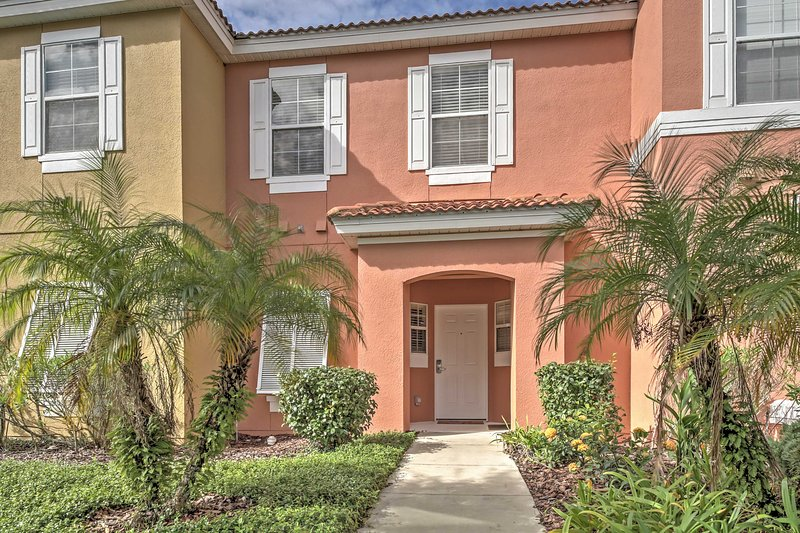 Let this colorful townhouse be your homebase for your Sunshine State getaway!