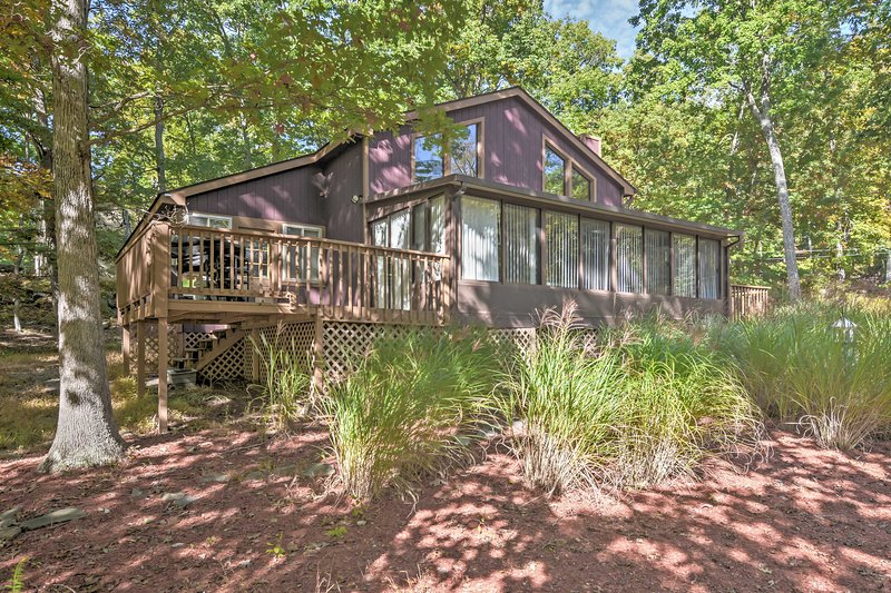Immerse yourself in the peaceful nature setting at this Poconos vacation rental.