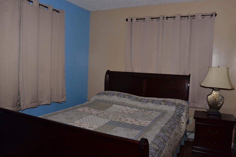 Queen size sleigh bed with dresser, nightstand and lamp.  All the comforts of home.
