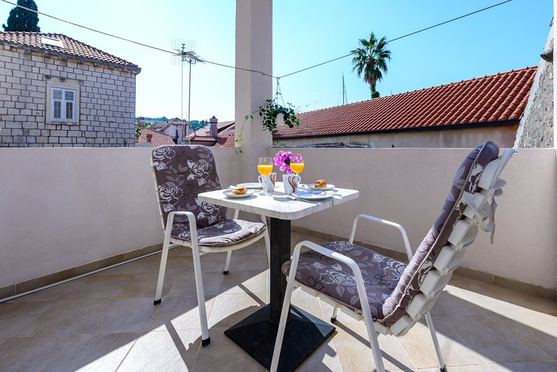 Furnished terrace suitable for outdoor dining