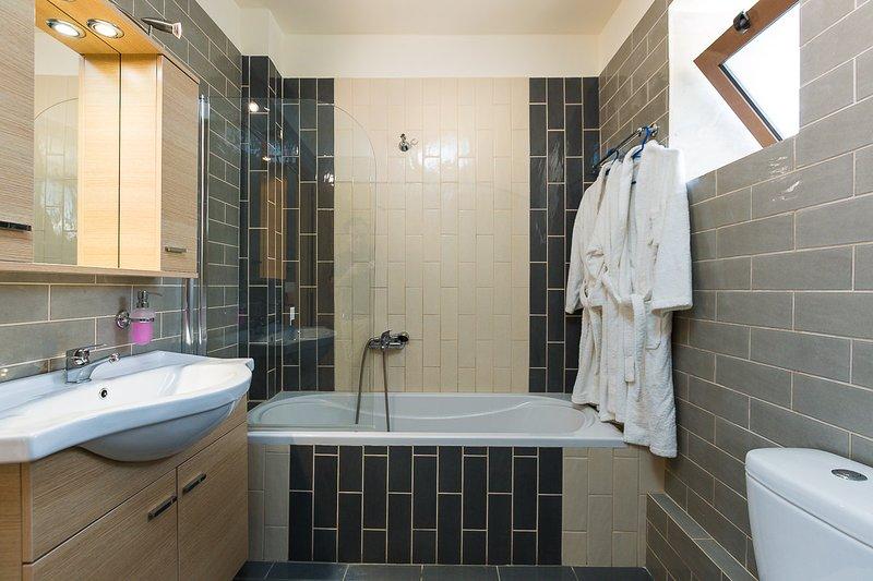 The first bathroom features a bathtub!