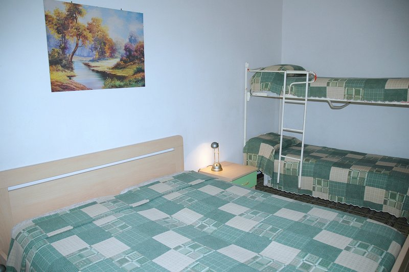 Bedroom with double bed and bunk bed