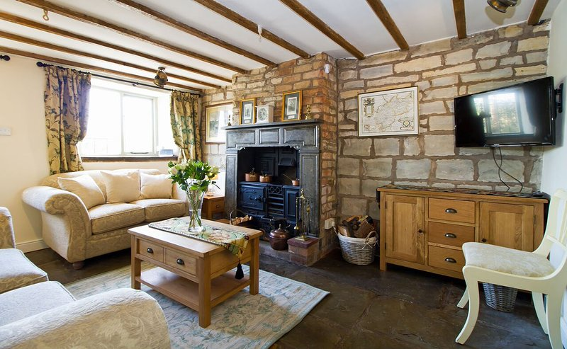 Cosy and characterful lounge with working range