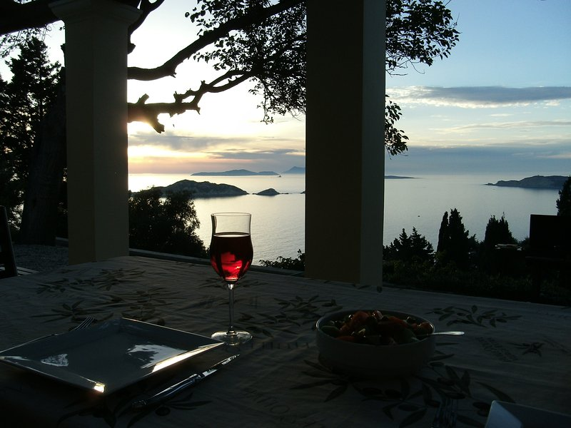 Dinner outside with stunning sunset views.